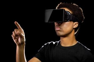 40764343 - virtual reality headset on a black male playing video games